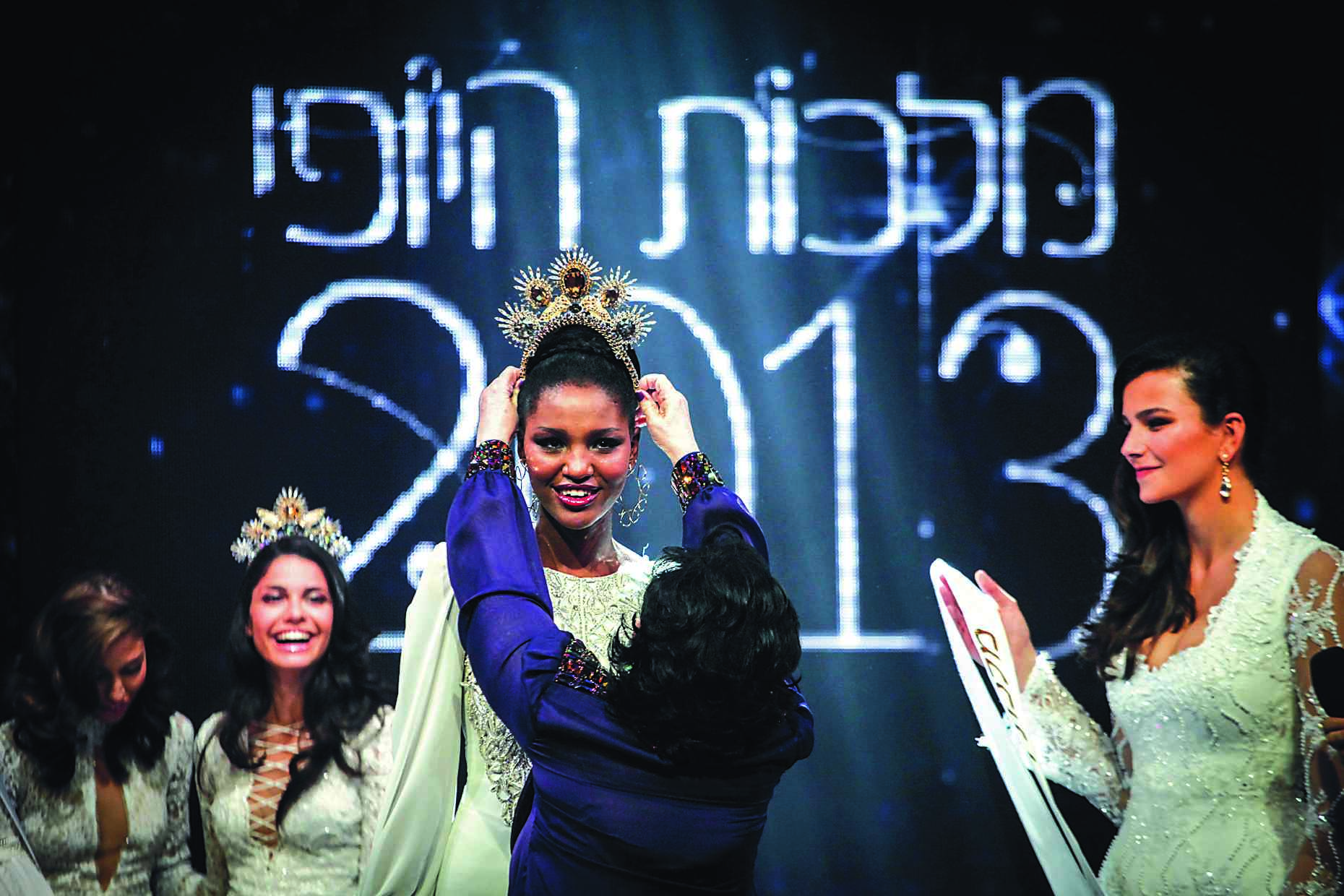 Yityish Aynaw a 21 year old Ethiopian-Israeli woman Ethiopian-Israeli woman won Israel's national beauty pageant and is the first Ethipian to win the pageant