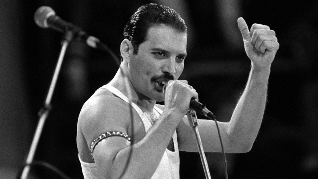 Freddie Mercury, of the pop band Queen, performing on stage during the Live Aid concert.